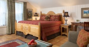 the bed and furnishings inside of the Chimayo Room