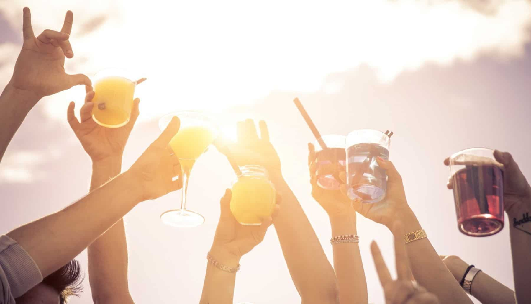 people raising glasses in the air